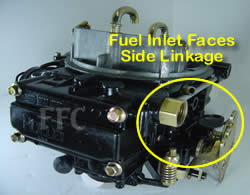 Picture of Y41-1ST four barrel Holley Model 4160 marine carburetor with fuel inlet facing the side throttle linkage