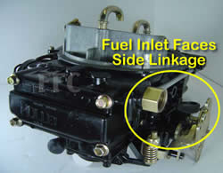 Picture of Y41 four barrel Holley Model 4160 marine carburetor with fuel inlet facing the side throttle linkage